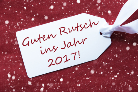 ins: One White Label On A Red Textured Background. Tag With Ribbon And Snowflakes. German Text Guten Rutsch Ins Jahr 2017 Means New Year