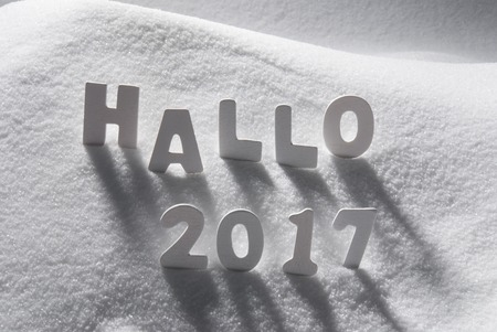 hallo: White Letters Building German Text Hallo 2017 Means Hello 2017 In Snow. Snowy Scenery For Happy New Year Greetings.