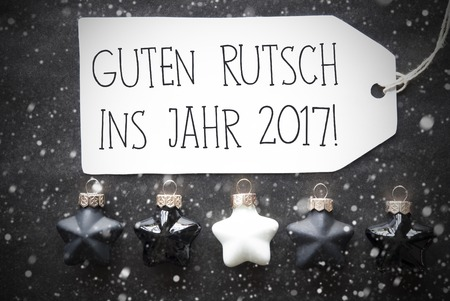 guten tag: Label With German Text Guten Rutsch Ins Jahr 2017 Means Happy New Year 2017. Black And White Christmas Tree Balls On Black Paper Background With Snowflakes. Christmas Decoration With Flat Lay View