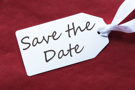 a meeting with a view to marriage: English Text Save The Date. One White Label On A Red Textured Background. Tag With Ribbon.