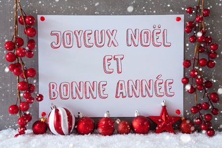 bonne: Label With French Text Joyeux Noel Means Et Bonne Annee Merry Christmas And Happy New Year. Red Christmas Decoration Like Balls On Snow. Urban And Modern Cement Wall As Background With Snowflakes. Stock Photo
