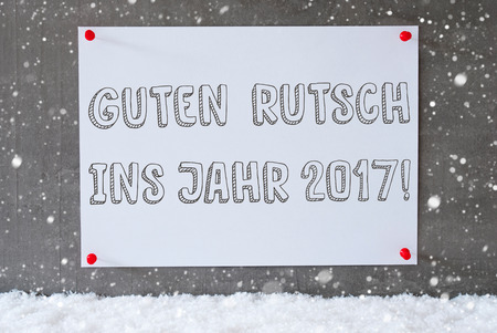 ins: Label With German Text Guten Rutsch Ins Jahr 2017 Means Happy New Year 2017. Urban And Modern Cement Wall As Background On Snow With Snowflakes. Stock Photo