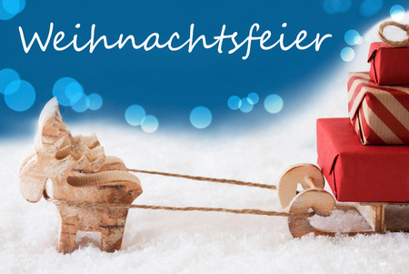 greetings card: German Text Weihnachtsfeier Means Christmas Party. Moose Is Drawing A Sled With Red Gifts Or Presents In Snow. Christmas Card For Seasons Greetings. Blue Background With Bokeh Effect.