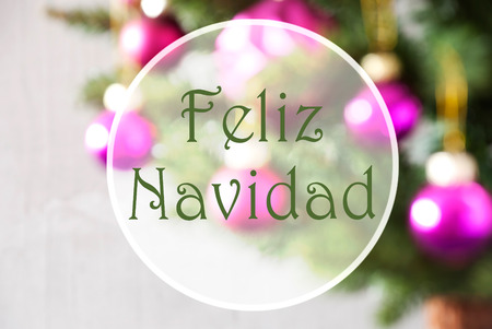 Spanish Text Feliz Navidad Means Merry Christmas. Christmas Tree With Rose Quartz Balls. Close Up Or Macro View. Christmas Card For Seasons Greetings.
