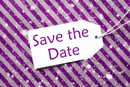 a meeting with a view to marriage: English Text Save The Date. One Label On A Purple Striped Wrapping Paper. Textured Background With Snowflakes. Tag With Ribbon.