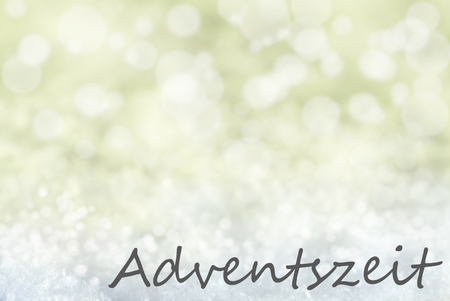 advent season: German Text Adventszeit Means Advent Season. Golden Bokeh Christmas Background Or Texture With Snow. Copy Space For Your Text Here