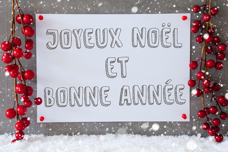 bonne: Label With French Text Joyeux Noel Et Bonne Annee Means Merry Christmas And Happy New Year. Red Christmas Decoration On Snow. Urban And Modern Cement Wall As Background With Snowflakes.