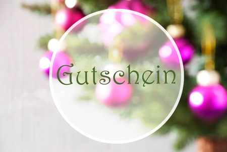 German Text Gutschein Means Voucher. Christmas Tree With Rose Quartz Balls. Close Up Or Macro View. Christmas Card For Seasons Greetings.