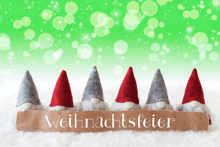 Label With German Text Weihnachtsfeier Means Christmas Party. Christmas Greeting Card With Gnomes. Sparkling Bokeh And Green Background With Snow, Snowflakes And Stars.