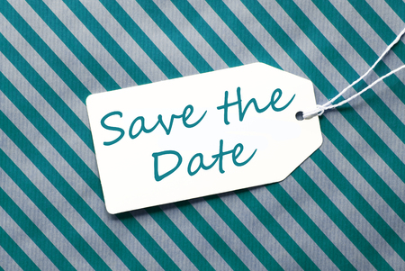a meeting with a view to marriage: English Text Save The Date. One Label On A Turquoise Striped Wrapping Paper. Textured Background. Tag With Ribbon.