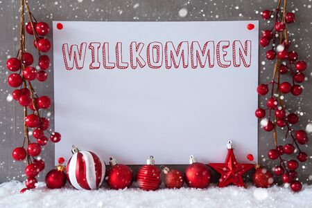 willkommen: Label With German Text Willkommen Means Welcome. Red Christmas Decoration Like Balls On Snow. Urban And Modern Cement Wall As Background With Snowflakes.