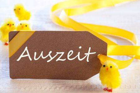 auszeit: Easter Label, Chicks, Auszeit Means Downtime Stock Photo