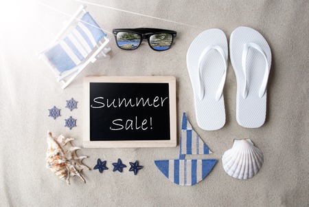 Sunny Blackboard On Sand With Text Summer Sale