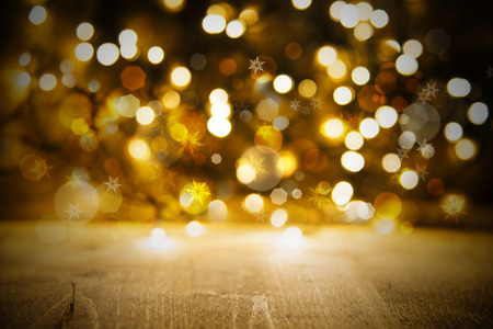 golden christmas lights background party or celebration texture with wood stock photo 84790129