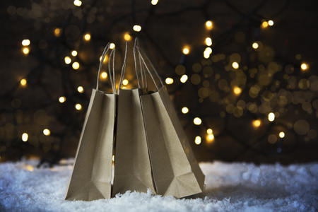 christmas shopping bag snow lights and bokeh stock photo 85559712