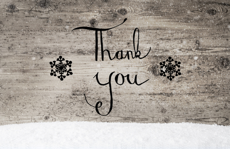 Calligraphy Thank You, Rustic Wooden Background, Snow Stock Photo