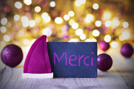 Plate, Santa Hat, Lights, Merci Means Thank You Stock Photo