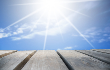 Wooden Board With Sunny Blue Sky As Background Stock Photo