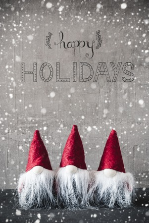 Three Red Gnomes, Cement, Snowflakes, Calligraphy Happy Holidays Stock Photo