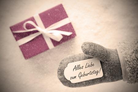 Pink Gift, Glove, Geburtstag Means Happy Birthday Stock Photo