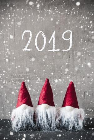 Three Red Gnomes, Urban Cement, Snowflakes, Text 2019 Stock Photo