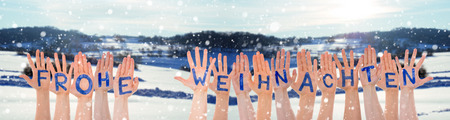 Many Hands Building German Word Frohe Weihnachten Means Merry Christmas. Snowy Winter Landscape With Snow As Background