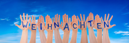 Many Hands Building Word Weihnachten Means Christmas, Blue Sky Stock Photo