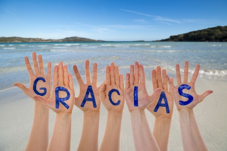 Many Hands Building Gracias Means Thank You, Beach And Ocean Stock Photo
