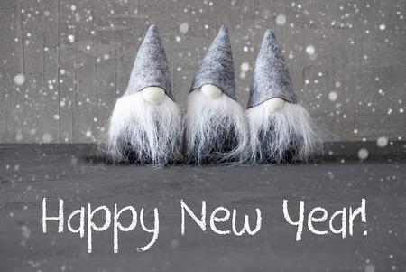 Three Gray Gnomes, Cement, Snowflakes, Happy New Year Archivio Fotografico