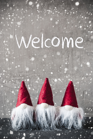 Three Red Gnomes, Cement, Snowflakes, Text Welcome Stock Photo