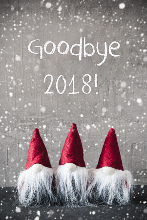 Three Red Gnomes, Cement, Snowflakes, Text Goodbye 2018 Stock Photo