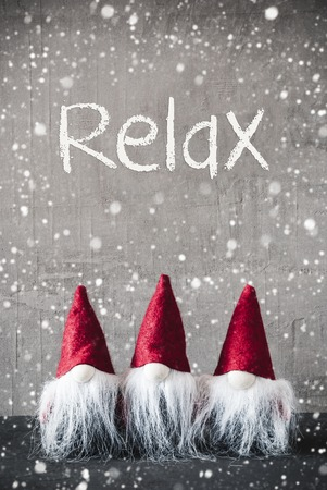 Three Red Gnomes, Cement, Snowflakes, Text Relax Stock Photo