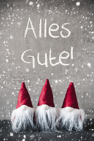 Red Gnomes, Cement, Snowflakes, Alles Gute Means Best Wishes Stock Photo