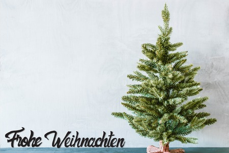Green Tree, Black Calligraphy Frohe Weihnachten Means Merry Christmas Stock Photo
