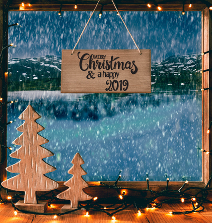 Christmas Window, Calligraphy Merry Christmas, Happy 2019, SNowflakes Stock Photo