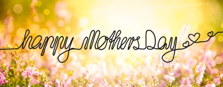 English Calligraphy Happy Mothers Day. Erica Flower Field Or Meadow. Sunny Spring Or Summer Season.