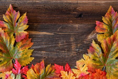 Colorful Leaves Autumn Decoration, Brown Wooden Background Imagens