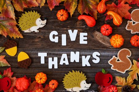 Colorful Autumn Decoration, Text Give Thanks, Wooden Background Imagens - 130686894