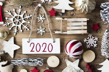 Rustic Christmas Flat Lay, Text 2020, Wooden Background Imagens