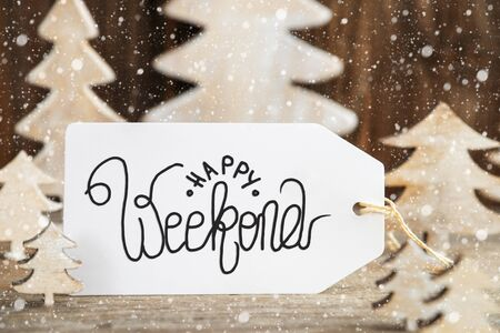 Label With English Text Happy Weekend. White Wooden Christmas Tree As Decoration. Brown Wooden Background With Snow