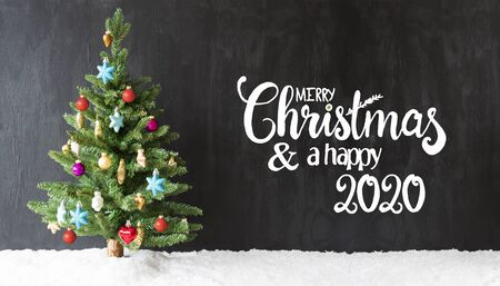 English Calligraphy Merry Christmas And A Happy 2020. Christmas Tree With Colorful Ball Ornament And Snow