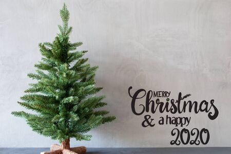 Egnlish Calligraphy Merry Christmas And A Happy 2020. Green Christmas Tree With Gray Background