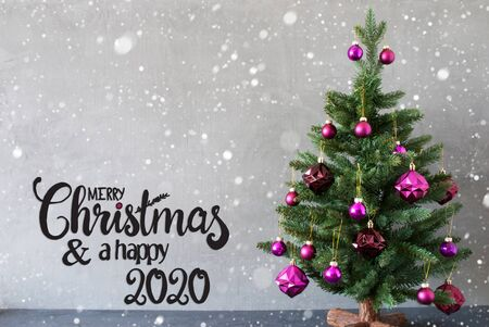English Calligraphy Merry Christmas And A Happy 2020. Tree With Purple Christmas Ball Ornament. Gray Background With Snowflakes