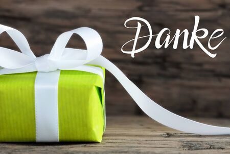 One Green Gift, White Bow, Wooden Background, Danke Means Thank You