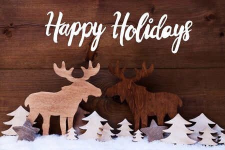 English Calligraphy Happy Holidays. White Wooden Tree And Moose On Snow WIth Wooden Background