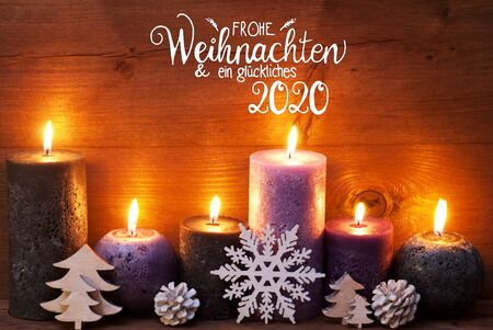 German Calligraphy Frohe Weihnachten Und Ein Glueckliches 2020 Mean Merry Christmas And Happy 2020. Purple Romantic Candle Light With Christmas Ornament. Brown Wooden Background