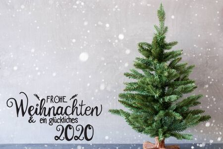 German Calligraphy Frohe Weihnachten Und Ein Glueckliches 2020 Mean Merry Christmas And A Happy 2020. Green Christmas Tree With Gray Concrete Background