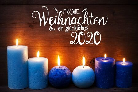 German Calligraphy Frohe Weihnachten Und Ein Glueckliches 2020 Mean Merry Christmas And Happy 2020. Turquoise Romantic Candle Light With Brown Wooden Background Banco de Imagens