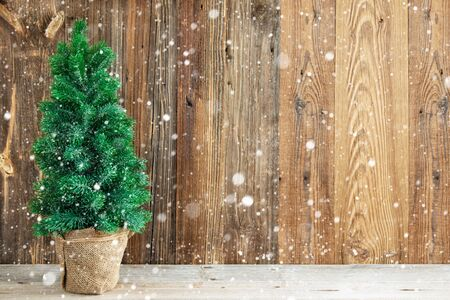 Wooden Backrground With Christmas Tree. Rustic Texture With Copy Space And Snow