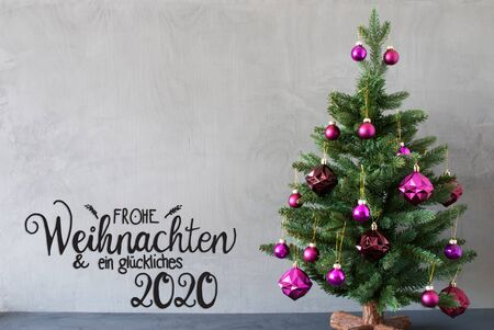 German Calligraphy Frohe Weihnachten Und Ein Glueckliches 2020 Mean Merry Christmas And A Happy 2020. Tree With Purple Christmas Ball Ornament. Gray Concrete Background.